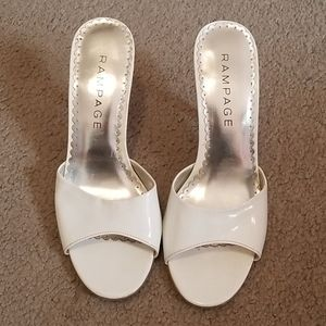 White patent heeled sandals